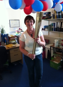 Myra Tait holds Olympic Torch