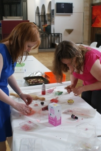 Aine and Sarah make cupcakes pretty with pink!